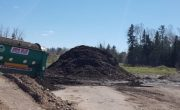 pile of compost beside trommel screen