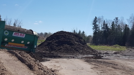 pile of compost beside trommel screen