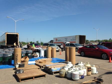 cars lined up dropping of hazardous waste