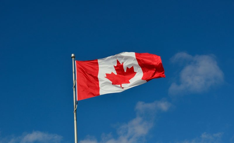 canada flag on blue sky