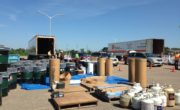 environmental day setup tractor trailers and pallets full of material