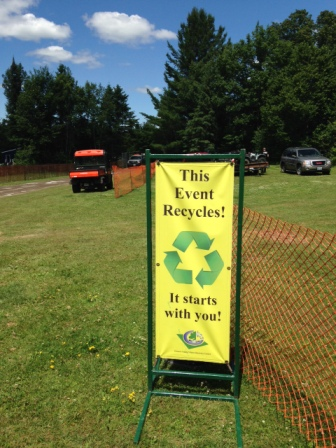 signs showing the recycling symbol with text this event recycles it starts with you