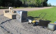 couch appliances lawn mower set at roadside for collection