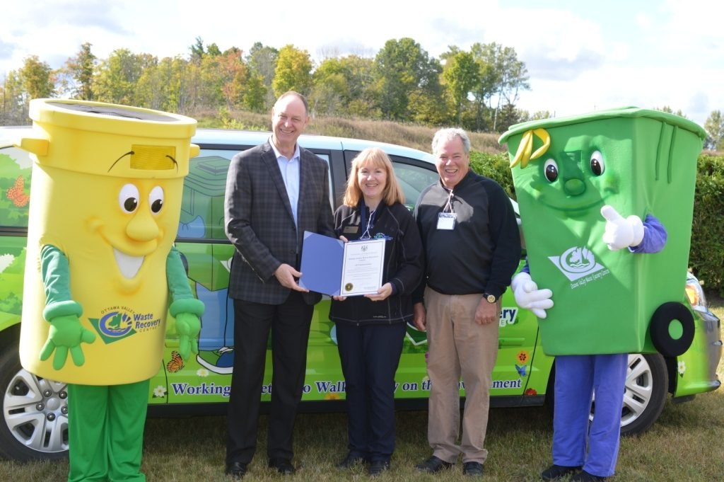 two OVWRC mascots with Chairmen Steve Bennett and OVWRC General Manager Sue MCCrae receive certificate from MPP John Yakabuski