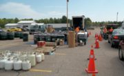 sorted hazardous waste on pallets beside line of traffic
