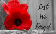 poppy with grey background and words lest we forget